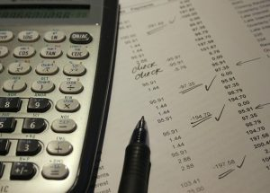 calculating-california-separate-property-reimbursement-rights-with-a-calculator-and-pen-300x215